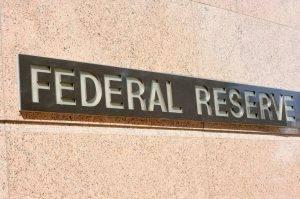 Riduzione del bilancio della Fed, implicazioni per azioni, volatilità e obbligazioni