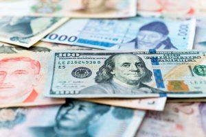 Debito emergente, sfruttare la dispersione tra valuta forte e valuta locale