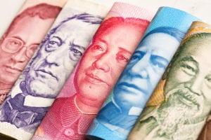 Dazi commerciali, uno scudo con titoli di stato USA e valute asiatiche